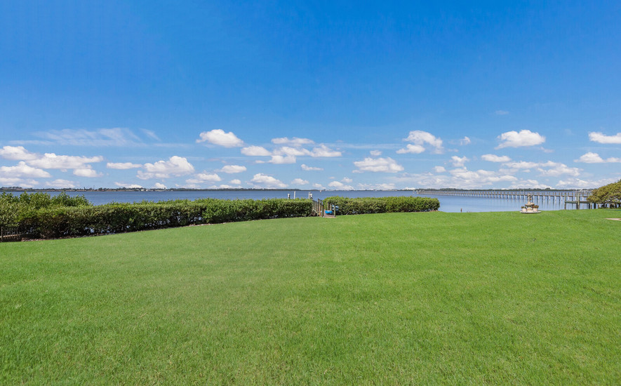 Large grassy yard and dock