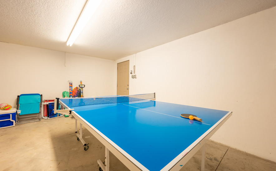 Ping pong and beach supplies in garage