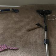 Carpet restretcher at work