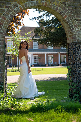 Bride in arch (1 of 1).jpg