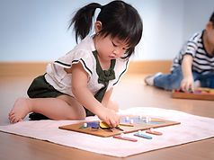 Montessori toddler girl working with puz
