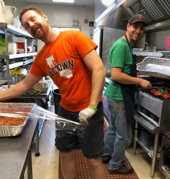 Two chefs work in the kitchen at Congregation Beth Shalom to prepare dinner for a Freda Fund birthday celebration.