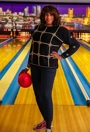 A woman prepares to bowl at a Freda Fund bowling party.