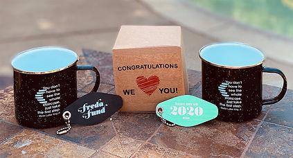 """Freda Fund 2020 grad gifts including mugs, key chains and a """"Congratulations we love you"""" gift box."""