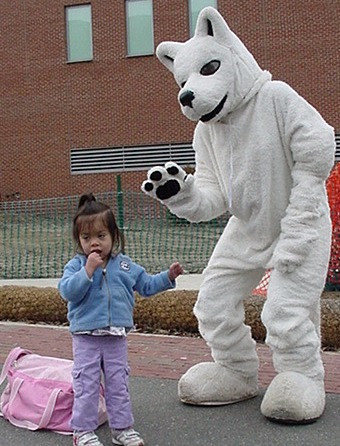Shelly, dressed as Jonathan the Husky, scaring a little girl during The Husky Innovation Challenge Kickoff