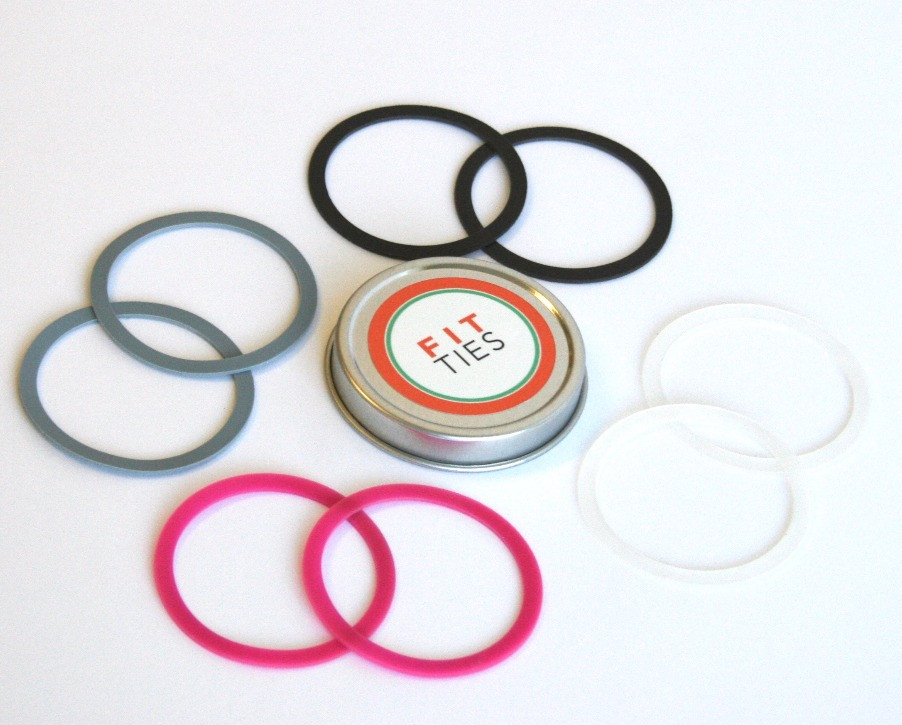 FIT TIES, packaged in metal tins, perfectly hold all of your hair ties together