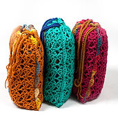 Pumpkin, Emerald and Magenta travel blankets in matching bags