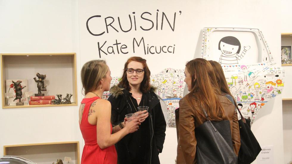 Kate Micucci Art Show Brad Oldham Sculpture Buyers Talking.jpg