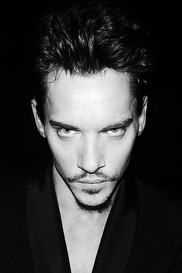 Jonathan Rhys Meyers is frowing his eyebrows.