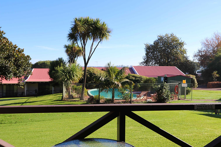 pool grass fence chairs garden accomodation pemberton