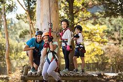 kids-enjoying-zip-line-adventure-on-sunny-day in Dwellingup.jpg
