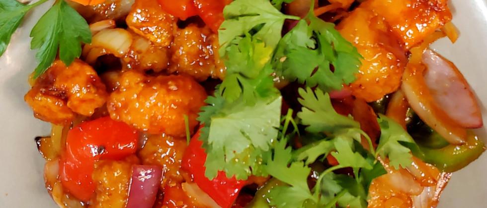 nr.41 Lättfriterad fiskfilé med wokade med paprika, lök, ingefära, chili, lime & koriander