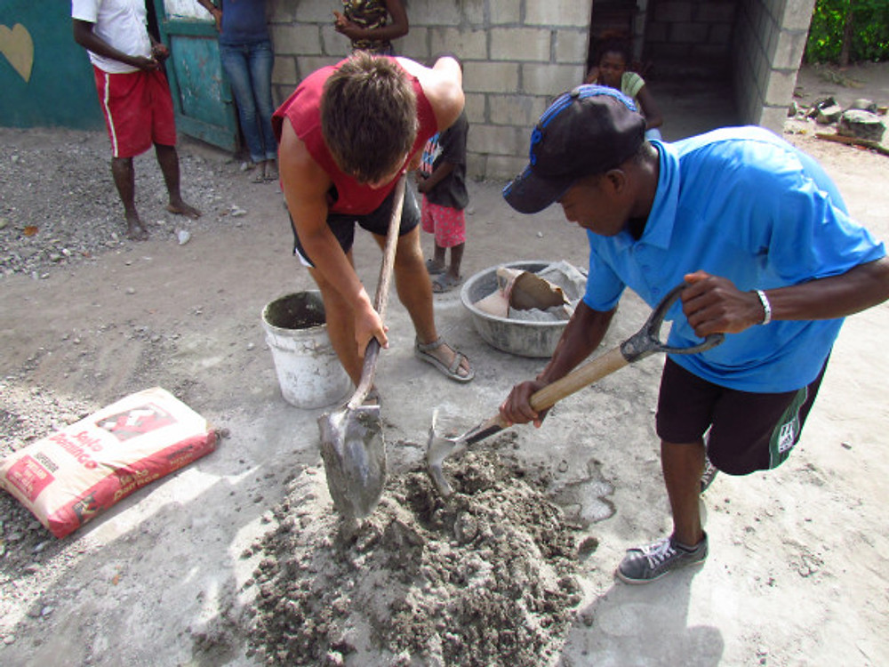 Stephen and a local mixing cement