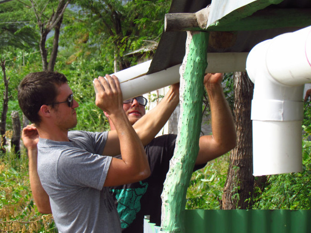 Ryan and Jamie working on the gutters