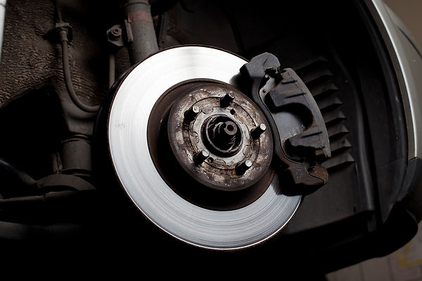 bigstock-Brake-Disc-And-Brake-Pads-22862627.jpg