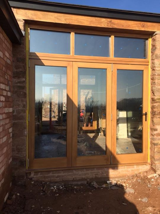 Accoya timber bifold doors with a 50 yea