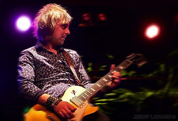 Mark Abrahams on stage with Wishbone Ash playing Gibson Les Paul Goldtop
