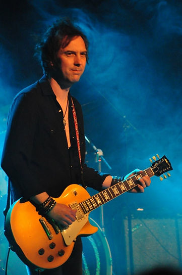 Mark Abrahams Session Guitarist on stage with Wishbone Ash playing a Gibson Les Paul