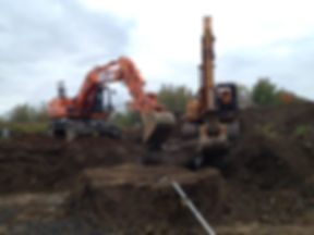excavation de fondation a bromont mur de roche paysagement granby