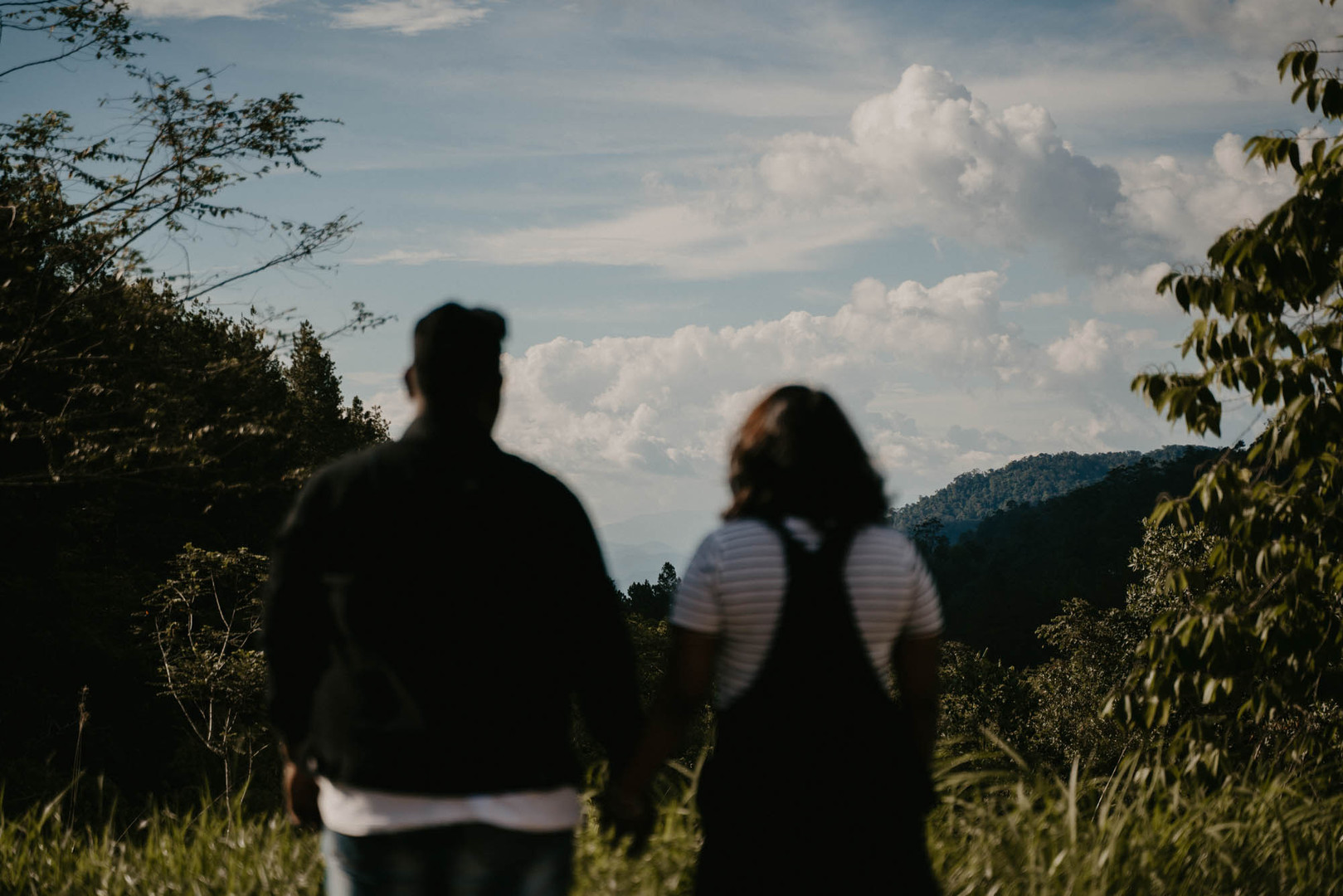 Inspired by {Catherine & Kevin}    Best weekend together:  The best weekend together was when we went up to Genting Highlands to take a ride on the cable car and then just hanging around, taking pictures. We even cooked and did a mini car picnic. It was simple but it was everything for us because time spent together is precious especially when we have busy schedules.    Favourite Memory Together: Late night car drives together, talking about anything and everything, we sing songs in the car. Getting ice cream from McDonalds and enjoying our alone time with sweet dessert. Dates at the mall, I would dare him to do things which he was never afraid of doing, for example, saying 'hello' to 10 random strangers or talking to a mannequin.    Insider jokes that only two of you understand: Once, we were coming back from the mall and we were listening to some music. So, the song 'I Can Feel Your Heartbeat' popped up and I was having a really bad tummy ache. I was leaning on his shoulder. So, while the song was playing, I had to let go some air and it smelled so terrible that he wind down all the windows and was just trying to gasp for clean air! Lol! From that moment, whenever the song pops up, he would look at me and give me the look of asking me if I was gonna silent attack him another time!