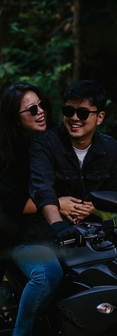 Inspired by {Ian & JiaMin}    I remember the first time ever sitting in his car, and finding out that he's secretly a badass, thrill-seeking mat rempit.    I think that was the moment I was smitten - hearing him talk about his mischievous rempit stories with so much excitement.    //    I remember the first time going on a bike with him. It was one random evening after work, he waited for me at the train station with an extra helmet in his hand. I remember that day like it was yesterday.    I ride more often with him these days, but I always remind myself never to take the familiarity of hugging him from the back with wind blowing on our faces for granted.    Macho as he may be, he tells people that when I get my bike license, he'll be the one sitting behind and holding my waist.    I know there are plenty of bikers out there, but I am sure meeting him was a divine appointment. He awakened so many dreams within me that I've never had courage to pursue; and one of which was of course, to get a motorcycle license myself.    9 months later (just yesterday!), I finally passed the JPJ test. And I know, soon, we will be exploring hidden alleys and undiscovered paths together by bike.    //    Seeing the dreams in each other's hearts, calling it out, pushing each other towards it, being there through long nights, giving hugs when the other person wants to give up and cheering loudly at the finish line.    That's what we'll always do for each other.  