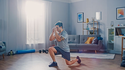 Strong Athletic Fit Man in T-shirt and S