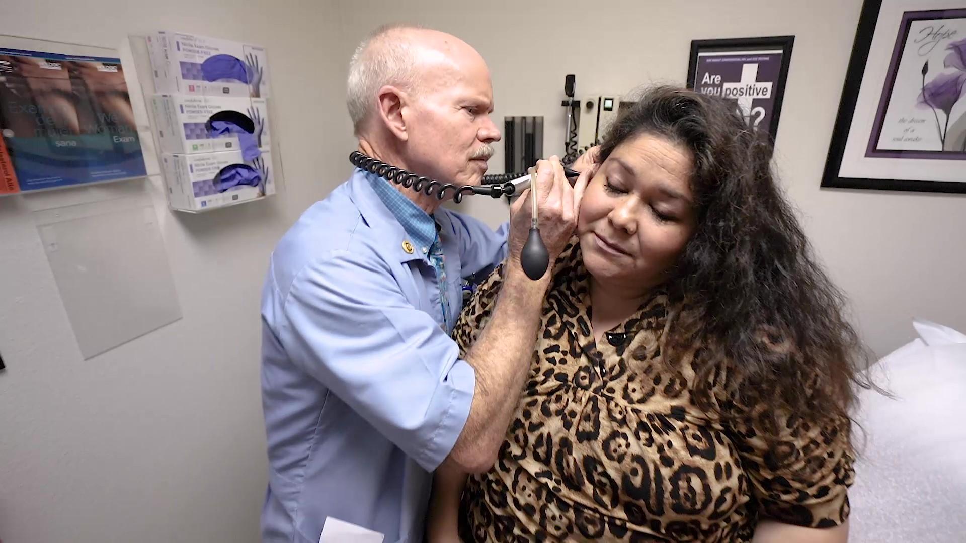 doctor examining ear.jpg