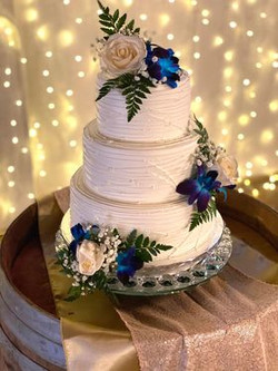"""Buttercream """"String"""" cake with blue orchids"""