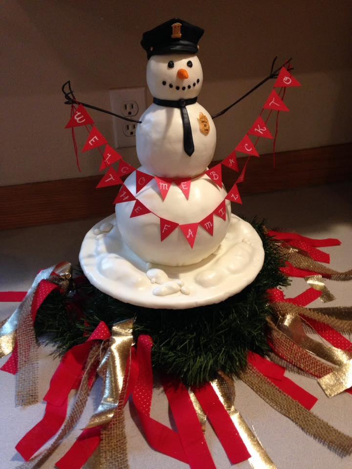 Welcome back snowman cake