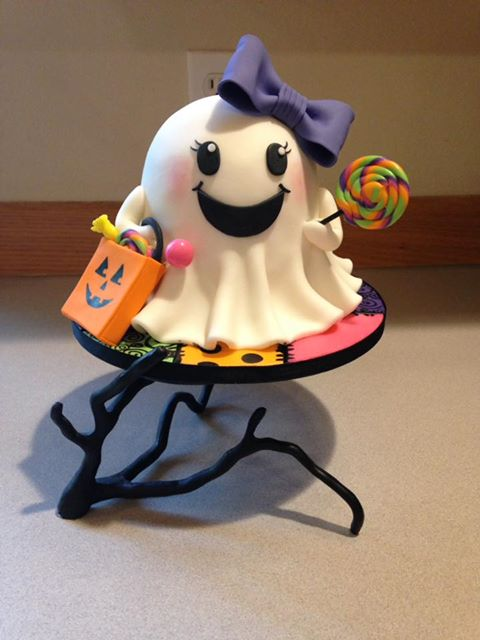 Little girl ghost smash cake