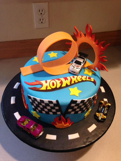 A awesome Hot Wheels cake for a boy.