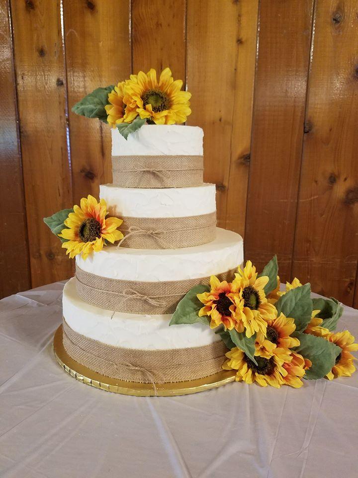 Spring wedding cake with sunflowers
