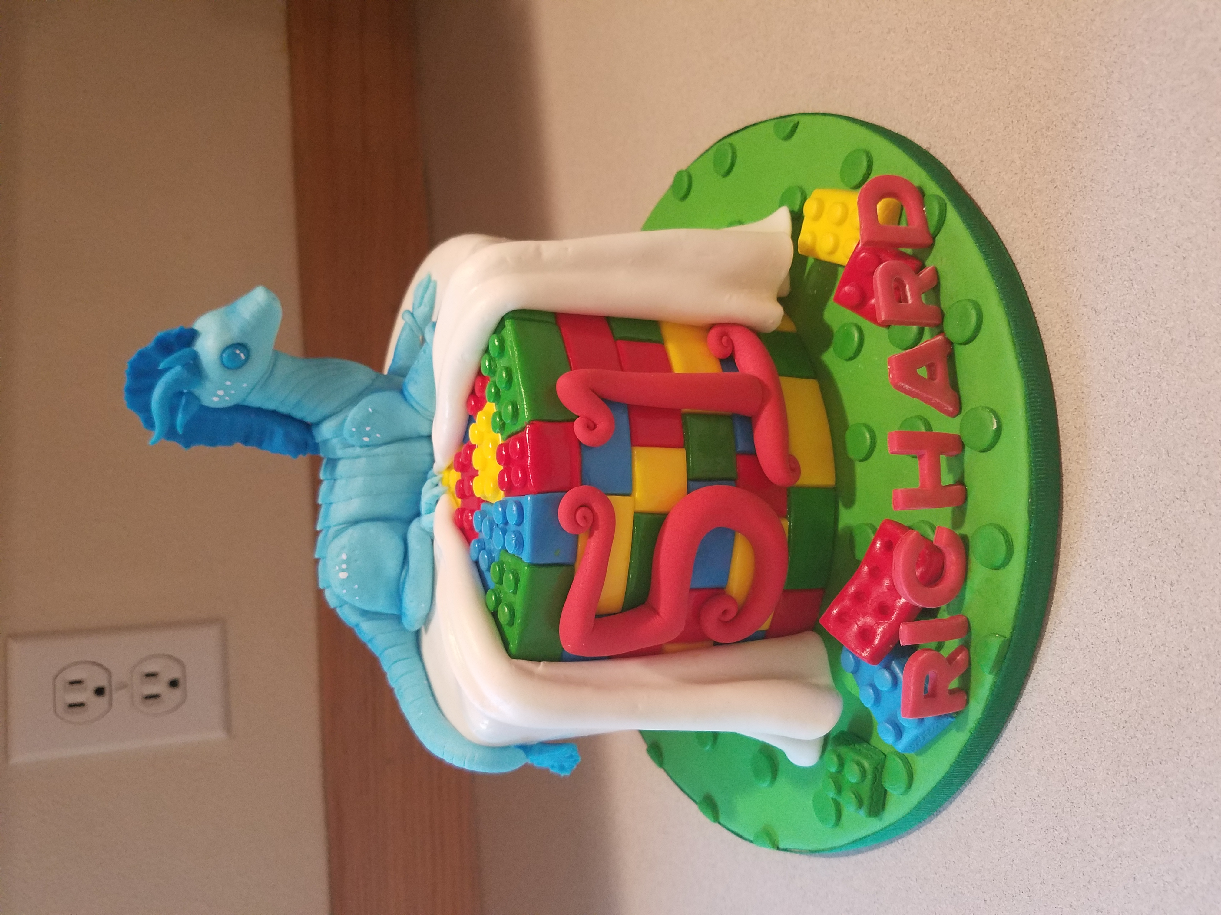 Toy dragon w/lego's cake