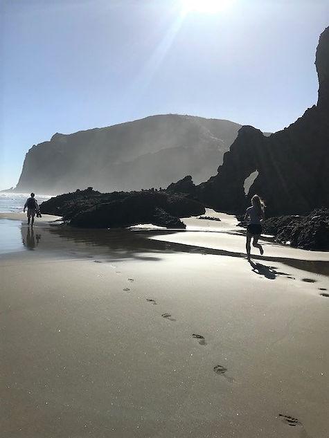 Caitlin runs across beach 2.jpg