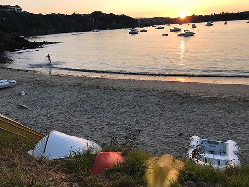 Evening shot Sandy Bay as swimmer runs i