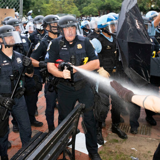 U.S. Secret Service officers fire tear gas at protesters who tried to pull down the Andrew Jackson statue on Monday, June 22, 2020.