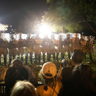 National Guard troops, clad in riot gear, protect Lafayette Square Park after pushing the barricades back to H street NW on Saturday, May 30, 2020.