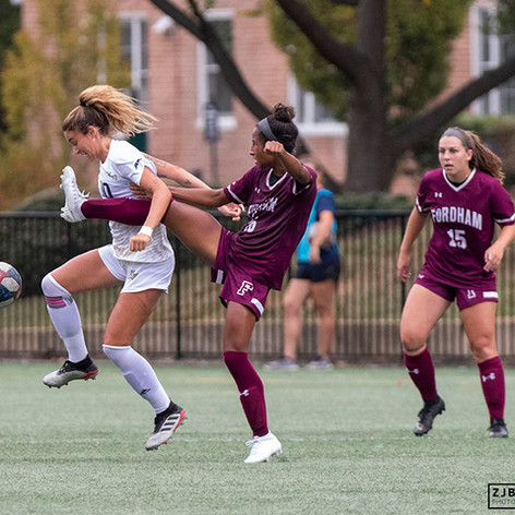 Fordham University sophomore forward Kendall Danridge kicks through the armpit of George Washington University sophomore midfielder Kelly Amador during a game at George Washington University on September 26, 2019. GW defeated Fordham 2-1.