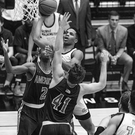 George Washington guard Jameer Nelson Jr. drives for a layup against American University.