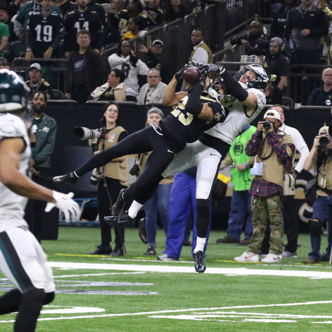 New Orleans Saints' defensive back Marshon Lattimore intercepts a pass from Eagles quarterback Nick Foles intended for tight end Zack Ertz during a 2019 divisional playoff game at the Mercedes Benz Superdome
