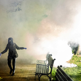 A protester emerges from a cloud of tear gas fired by U.S. Park Police in Lafayette Square Park on May 31.