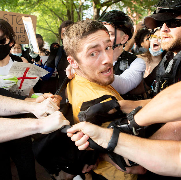 Protesters and U.S. Secret Service agents struggle while trying to detain a protester in Lafayette Square Park in Washington, D.C. on Friday, May 29.