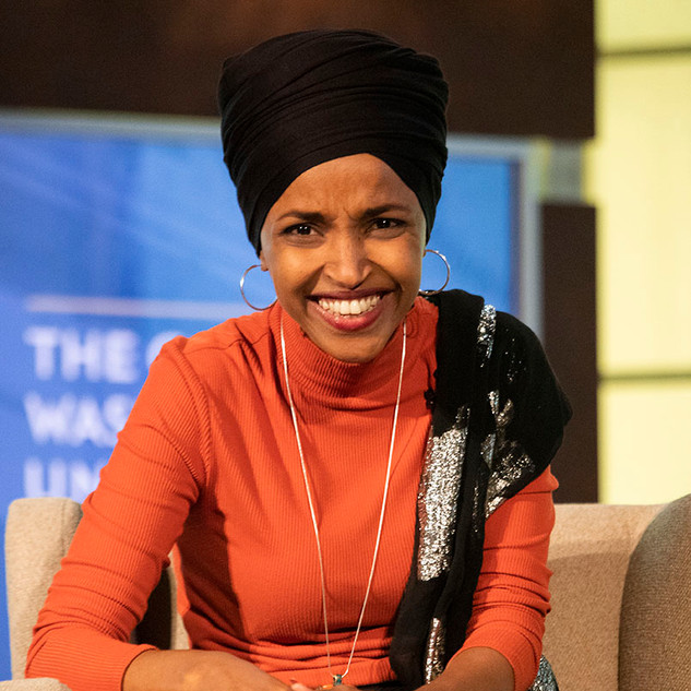 "Rep. Ihan Omar (D-Minn.) laughs during a live recording of the ""Deconstructed Podcast"" hosted by Mehdi Hasan at George Washington University on October 23, 2019."