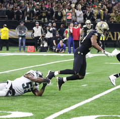 New Orleans Saints' wide reciever Michael Thomas slips a tackle from Eagles' linebacker  Nigel Bradham during a 2019 divisional playoff game at the Mercedes Benz Superdome