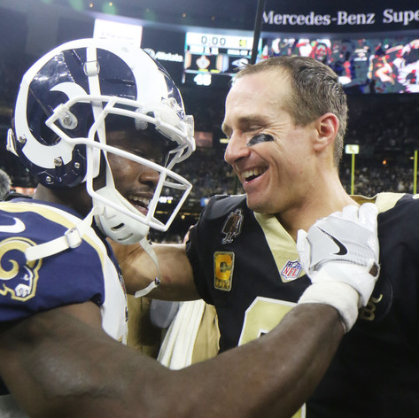Los Angeles Rams' wide reciever Brandin Cooks, left, greets his former quarterback Drew Brees, right, at midfield after the Saints defeated the Rams on Sunday, November 4.