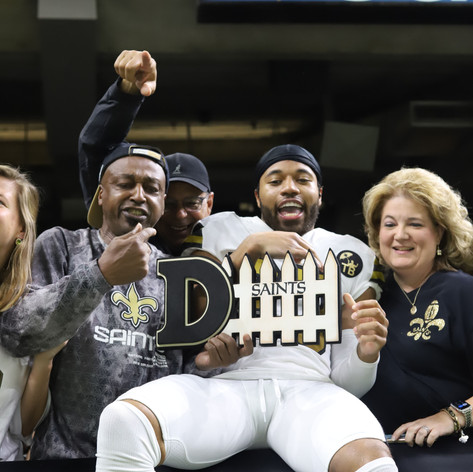 New Orleans Saints' defensive back Marshon Lattimore leaps into the stands to celebrate a turnover.
