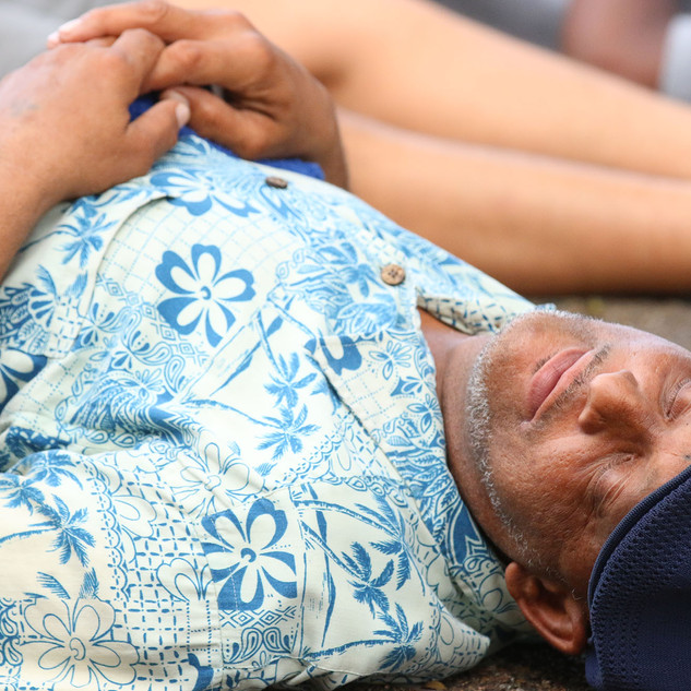"Roland Washington partakes in a ""die-in"" in front of NOPD headquarters on July 8, 2016. The event drew dozens of participants who laid face-down on the ground to stand in solidarity with those who have lost their lives at the hands of police officers."