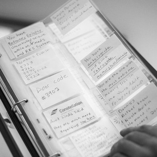 Jim uses a binder to hold excess notes he used to remember important information