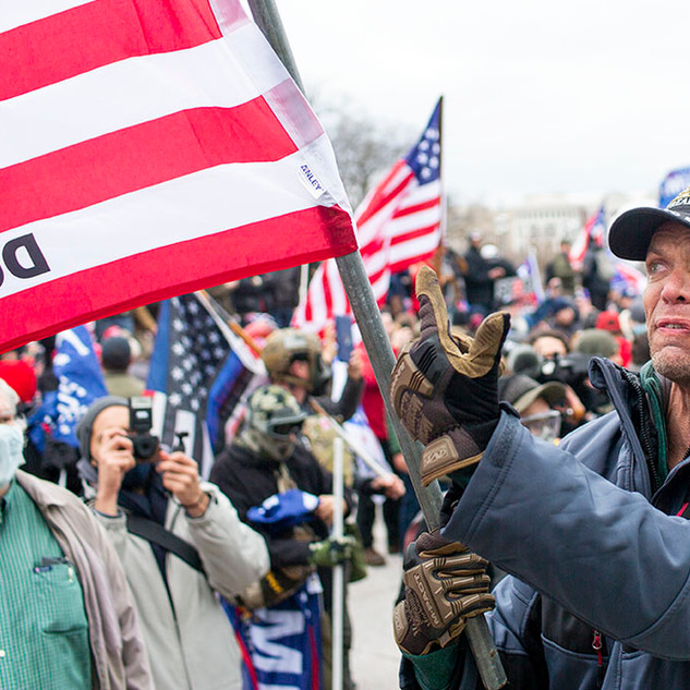 A man waiving a combination Gadsden and U.S. Flag yells at U.S. Capitol Police on January 6, 2020. Later that afternoon, pro-Trump protesters broke into the U.S. Capitol building, resulting in multiple deaths, including one Capitol Hill police officer.