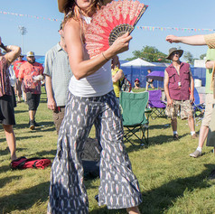 Maya Cook dancing to the Cha Wa Band at the New Orleans Jazz and Heritage Festival, 2016